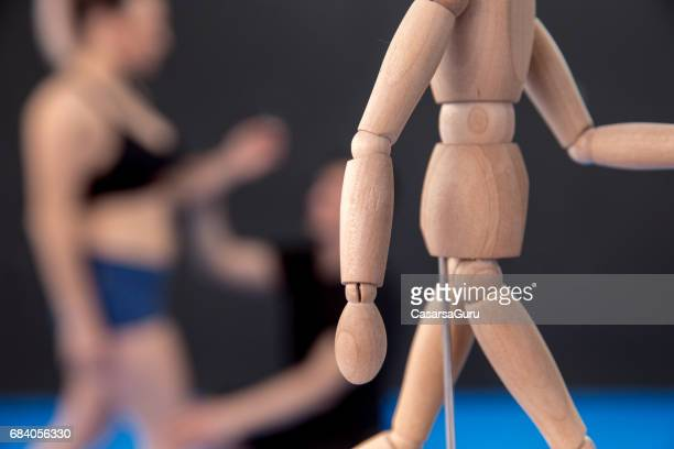 therapist showing on the wodden mannequin how to improve the posture - good posture stock pictures, royalty-free photos & images
