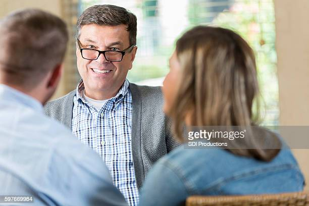 Therapist smiles while counseling couple
