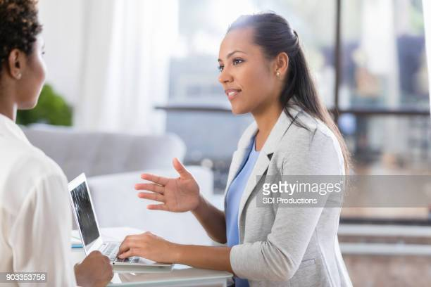 therapist uses laptop while talking with patient - asking stock pictures, royalty-free photos & images
