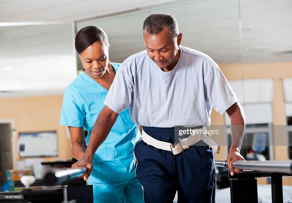 Therapist with patient doing gait training : Stock Photo
