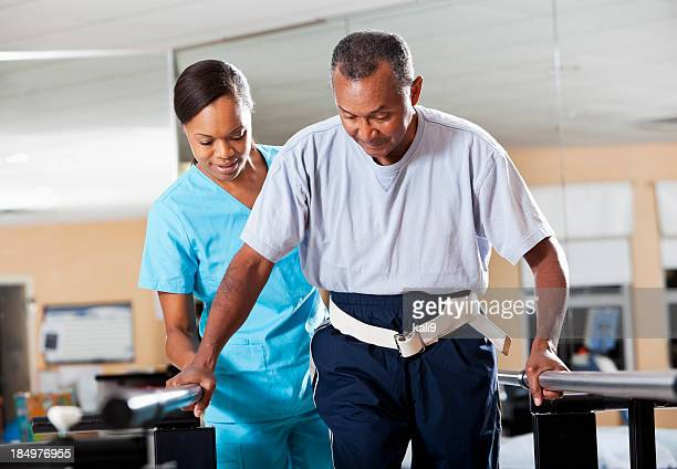 therapist with patient doing gait training - bounce back stock photos and pictures
