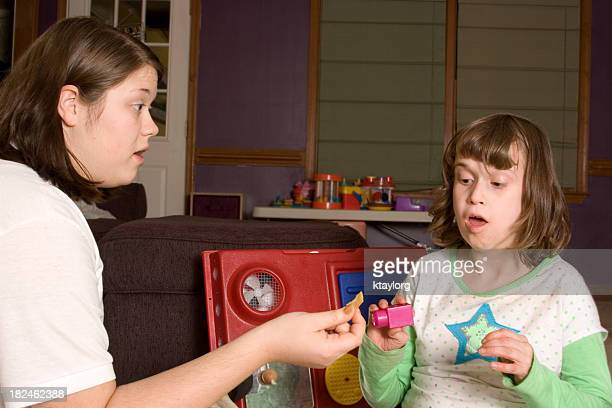 ABA therapist working with autistic little girl