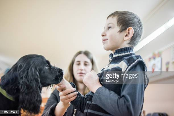 Therapy dog session in Training and Rehabilitation Center for Children with Developmental Disabilities in Fastiv Kiev Oblast Ukraine on March 15 2018