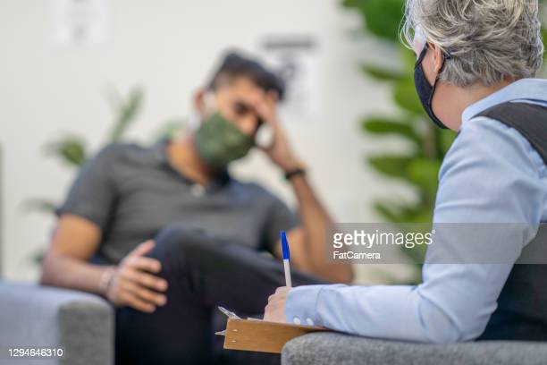 therapy session during pandemic - fatcamera stock pictures, royalty-free photos & images
