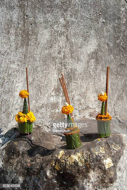 Theravada Buddhism, religious offerings at a wall, That Chomsi on Mount Phu Si, Luang Prabang province, Laos, Southeast Asia, Asia