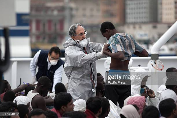 There are about 650 refugees and a dead person being disembarked from the Coast Guard ship Bruno Gregoretti in the city's main port Aboard Central...