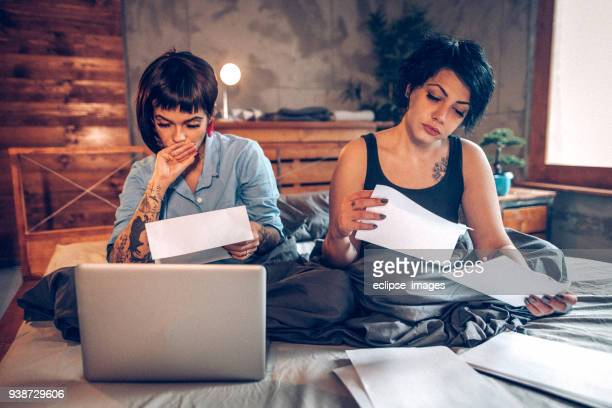 there are bills to be paid - lesbian date stock pictures, royalty-free photos & images