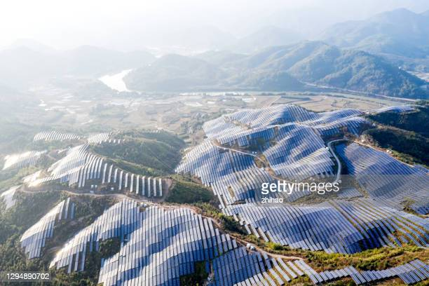 there are magnificent solar power plants on top of rolling hills - power supply stock pictures, royalty-free photos & images