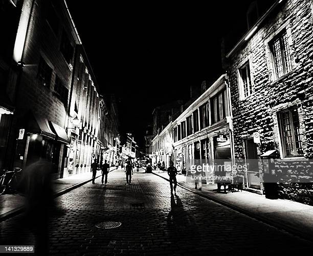 There are many shadows and silhouettes in Old Montreal late at night