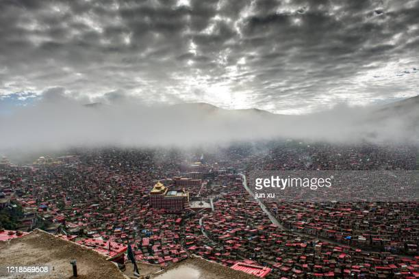 there are rows of red houses in the valley - nigeria stock pictures, royalty-free photos & images