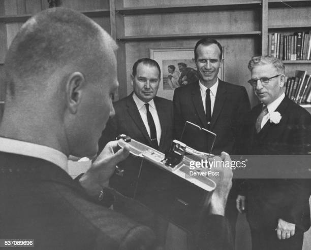 There are two Negatives Involved in this Picture One is in the camera held by the Rev Gene L McCornack taking picture of new officers of the Colorado...