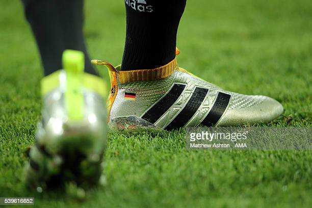 There flag of Germany on the back of the Adidas football boots worn by Julian Draxler of Germany during the UEFA EURO 2016 Group C match between...