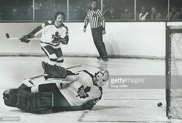 There Goes The Shutout With career as National Hockey League goalie only 2 minutes and 28 seconds old Leafs' Gordon McRae watches bouncing puck head...