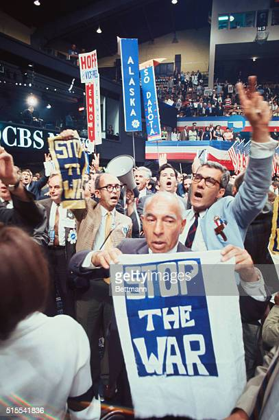 There is a commotion on the floor of Convention Hall 8/28 after the 3rd session recessed Delegates marched around the floor carrying 'Stop the War'...