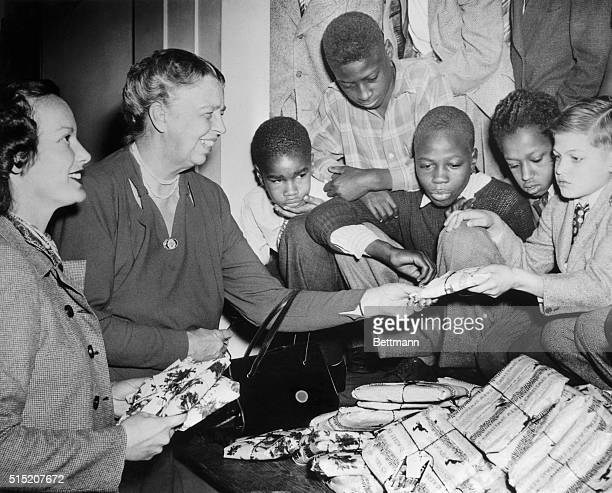 There is a gift for everyone at the Wiltwyck School for Boys as Mrs Franklin D Roosevelt with the aid of her daughterinlaw Faye Emerson Roosevelt...