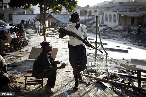 There is a tense stand off between looters and heavily armed police in the commercial district of downtown Port au Prince as people become more...