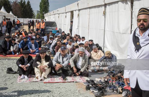 There is no more room in the tent where people have gathered for a Friday prayer and to hear Caliph Mirza Masroor Ahmad the spiritual leader of the...