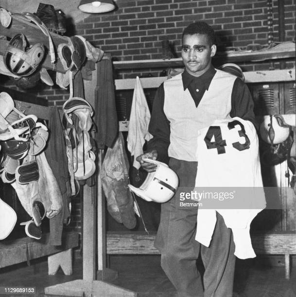 There is no sparkle to Johnny Bright as he hangs up his football togs for the last time in the Drake University locker room. The All-American Bulldog...