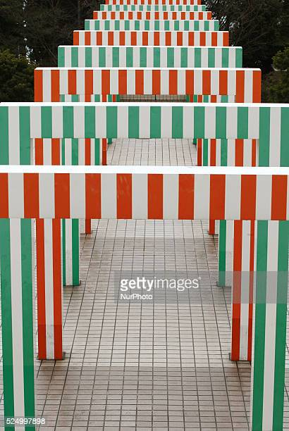 There is the gate that quot25 Porticosquot by French designer Daniel Buren is colorful in Odaiba Tokyo June 17 2015 This gate is considered to be the...