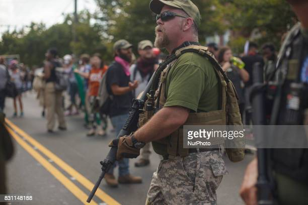 There were dozens of protesters with large rifles present at the Unite The Right rally on 12 August 2017 in Charlottesville Virginia USA The Unite...