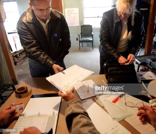 There you go and here you go poll worker Eddie Powell says to voters James Edwards and Peggie Shannon This is a paper ballot We got to vote the old...