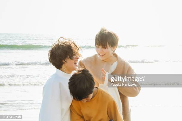 theree teenagers laughing while talking - yusuke nishizawa bildbanksfoton och bilder