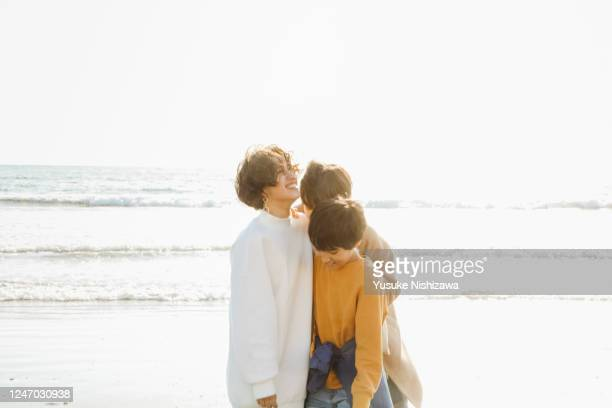 theree teenagers laughing while talking - yusuke nishizawa stock pictures, royalty-free photos & images