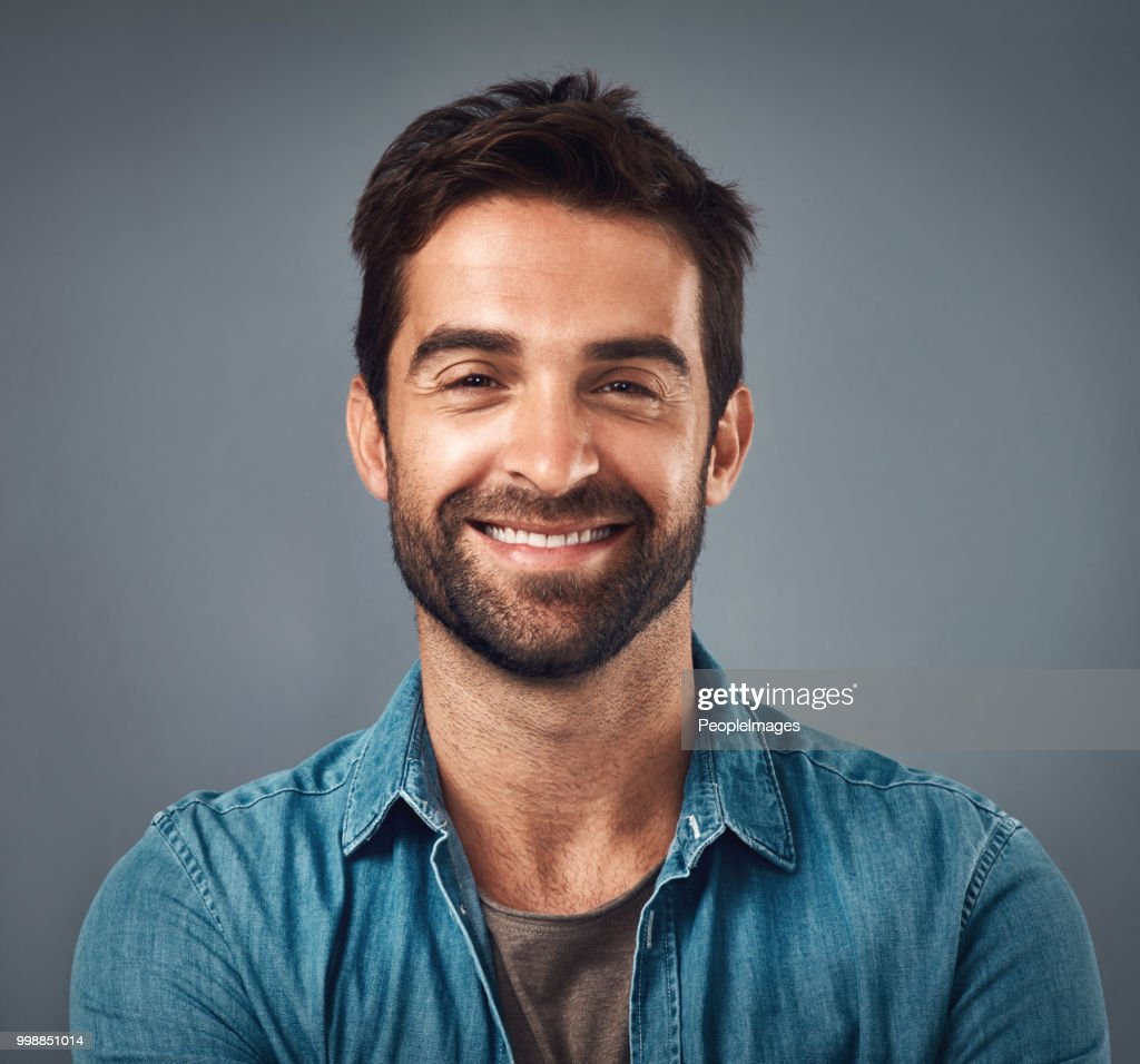 There's a reason they call him handsome : Stock Photo