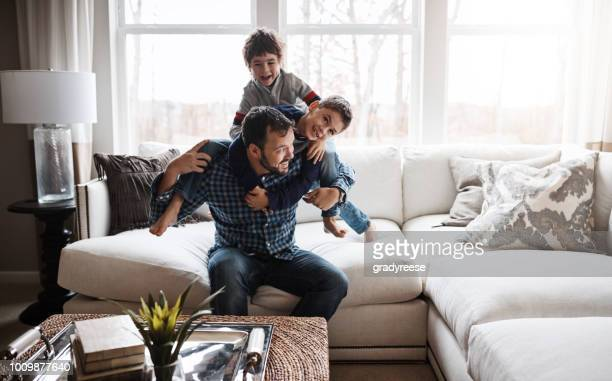 there's always time for family time - rough housing stock pictures, royalty-free photos & images