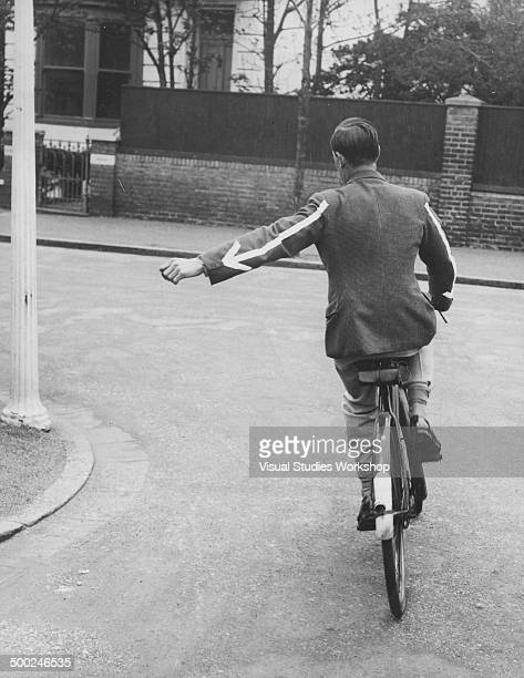 There's no mistaking the signals of this tradesman while out cycling on his rounds in his homemade jacket where the arrows are made of tape and are...
