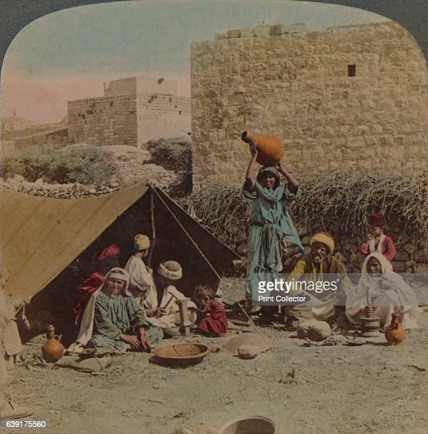There's no place like home dwelling and shop of a Gypsy Blacksmith Syria 1900 From The Underwood Travel Library [Underwood Underwood London New York...