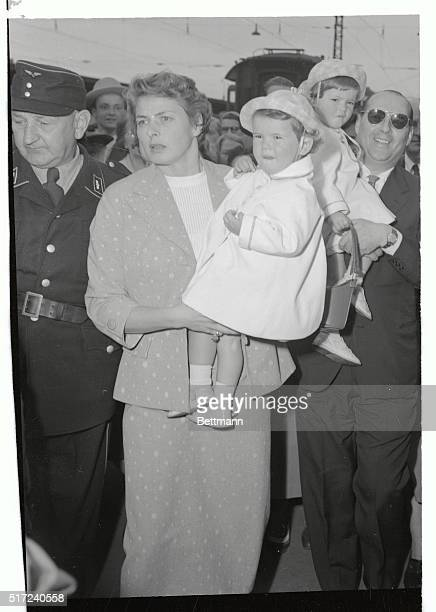 There's no such thing as traveling light for actress Ingrid Bergman who's arriving in Munich with husband Italian director Roberto Rossellini with...