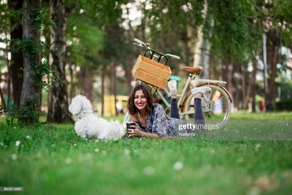 There's Nothing As Beautiful As Drinking Coffee, Listening To Music And To Laze With Vivid Pet On Sunny Leisure Day : Stock Photo