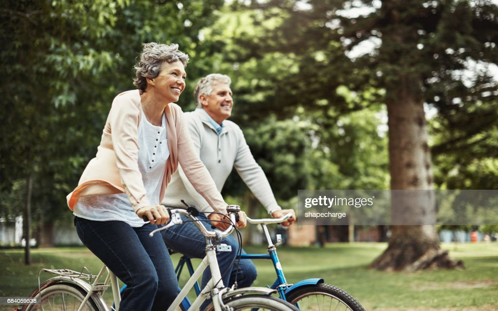 There's nothing better than enjoying a bike ride together : Stock Photo