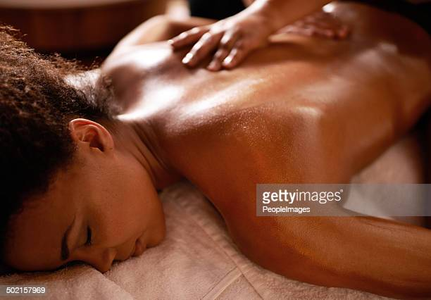 there's nothing more relaxing than this... - black massage therapist stock photos and pictures