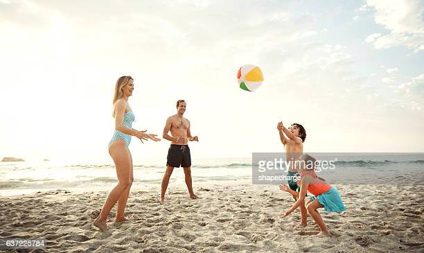 there's nothing more simple and fun as a beach ball - catching stock pictures, royalty-free photos & images