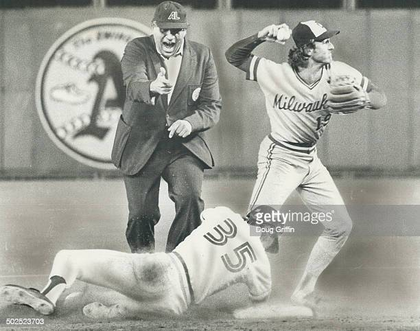 There's plenty of action here Second base umpire Ron Luciano is at his vociferous best calling out Blue Jay's sliding Gary Woods Robin Yount...