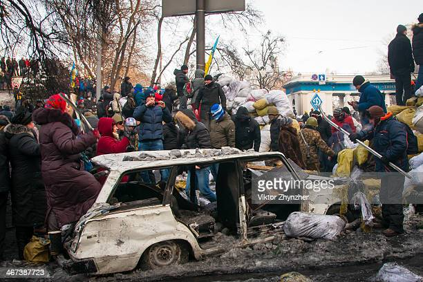 CONTENT] There's the biggest drum on Grushevskogo st during national confrontation in Kiev Ukraine at Jan 25 2014 where even women practise to take a...