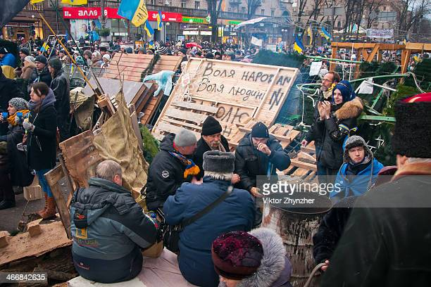 There's the one of Independence square places named as EuroMaidan where entrance guards have possibility to get warm and eat. Kiev, Ukraine at Dec 8,...