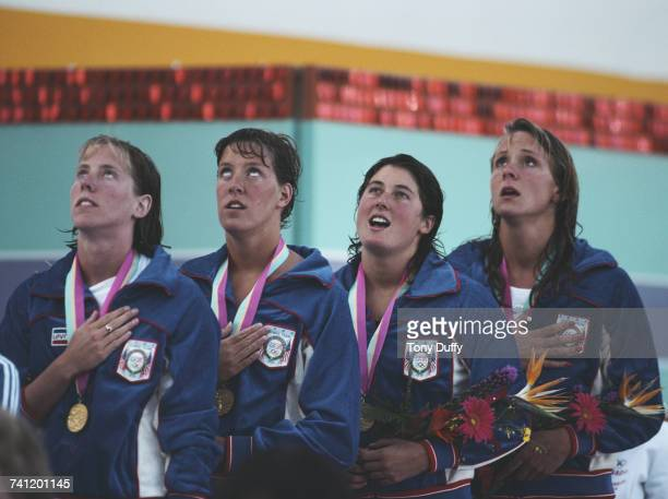 Theresa AndrewsTracy CaulkinsMary Meagher and Nancy Hogshead of the United States singing the national anthem during the gold medal ceremony for the...