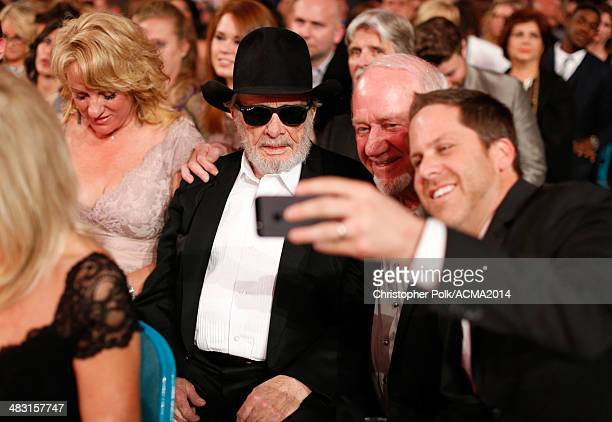 Theresa Ann Lane and recording artist Merle Haggard take a selfie with fans during the 49th Annual Academy of Country Music Awards at the MGM Grand...