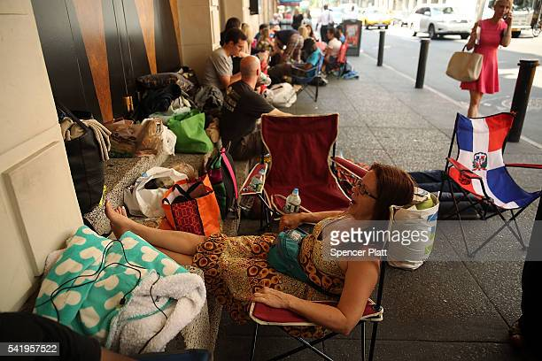 Theresa Cardamone waits with dozens of others many who have been there for days for tickets for the popular Broadway show Hamilton on June 21 2016 in...