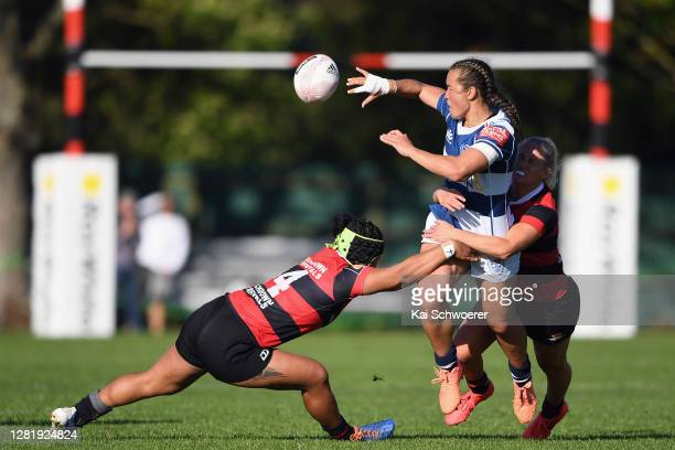 Theresa Fitzpatrick of Auckland offloads the ball during the Farah Palmer Cup Semi Final match between Canterbury and Auckland at Rugby Park on...
