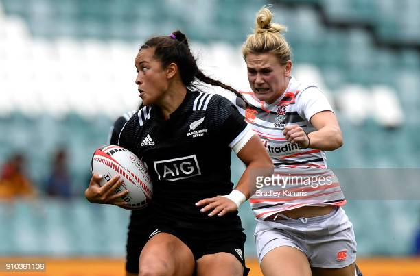 Theresa Fitzpatrick of New Zealand breaks away from the defence in the match against England during day one of the 2018 Sydney Sevens at Allianz...