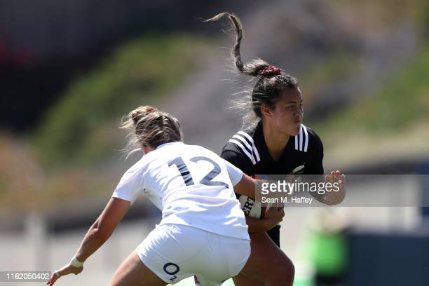 Theresa Fitzpatrick of New Zealand eludes Emily Scott of England during the second half of a match between New Zealand and England in the Women's...