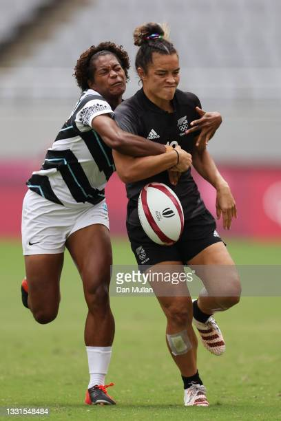 Theresa Fitzpatrick of Team New Zealand is tackled by Laisana Likuceva of Team Fiji in the Women's Semi Final match between Team New Zealand and Team...