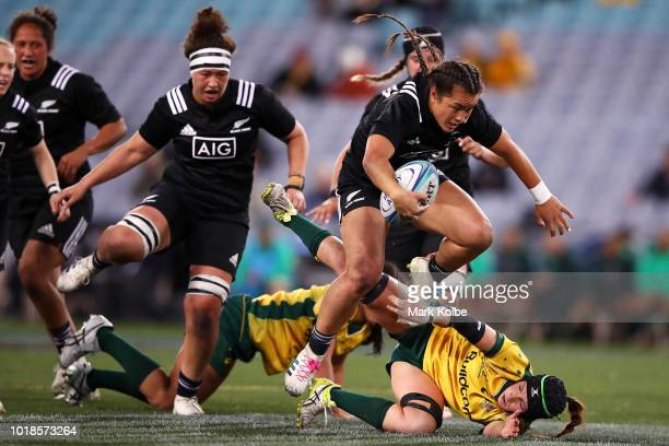 Theresa Fitzpatrick of the Black Ferns jumps over a Wallaroos defender during the Women's Rugby International match between the Australian Wallaroos...