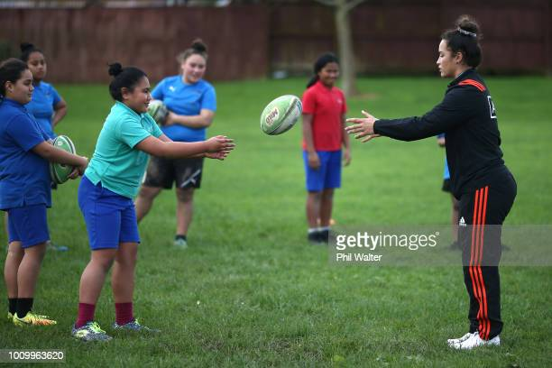 Theresa Fitzpatrick of the Black Ferns leads school children in some basic rugby skills and fitness training during the the New Zealand Black Ferns...