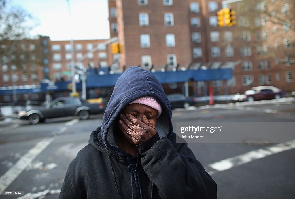 Theresa Goddard, her apartment still without electricity, is overwhelmed while discussing her living conditions on November 8, 2012 in the Brooklyn borough of New York City. She and many other residents of the Red Hook public housing projects also remain without heat and running water due to Superstorm Sandy. Meanwhile a nor'easter storm plunged temperatures to below freezing.
