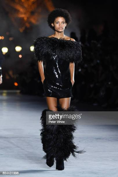 Theresa Hayes walks the runway during the Saint Laurent show as part of the Paris Fashion Week Womenswear Spring/Summer 2018 on September 26 2017 in...